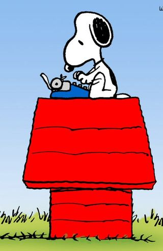 Snoopy typing on dog house